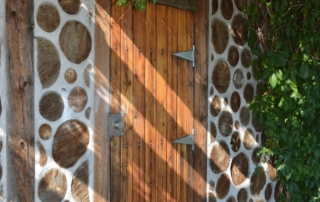 Detail of Cordwood Wall at the Community Garden