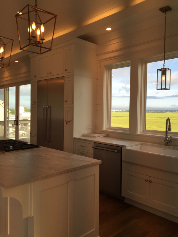 Kitchen with wall of windows to marsh view