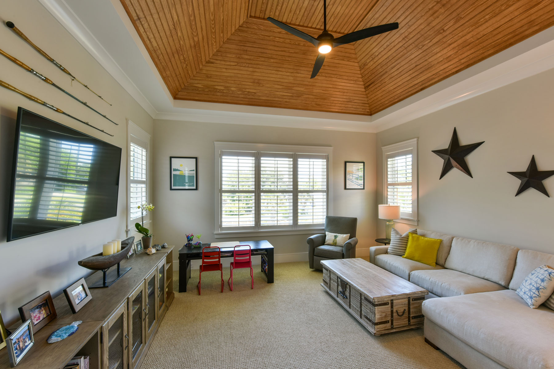 Kids family room with vaulted, wood ceiling