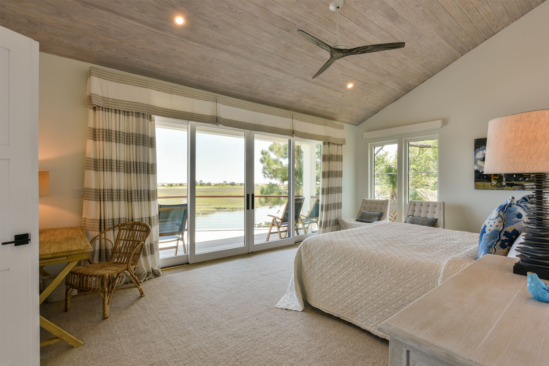 Renovated master bedroom with waterway view