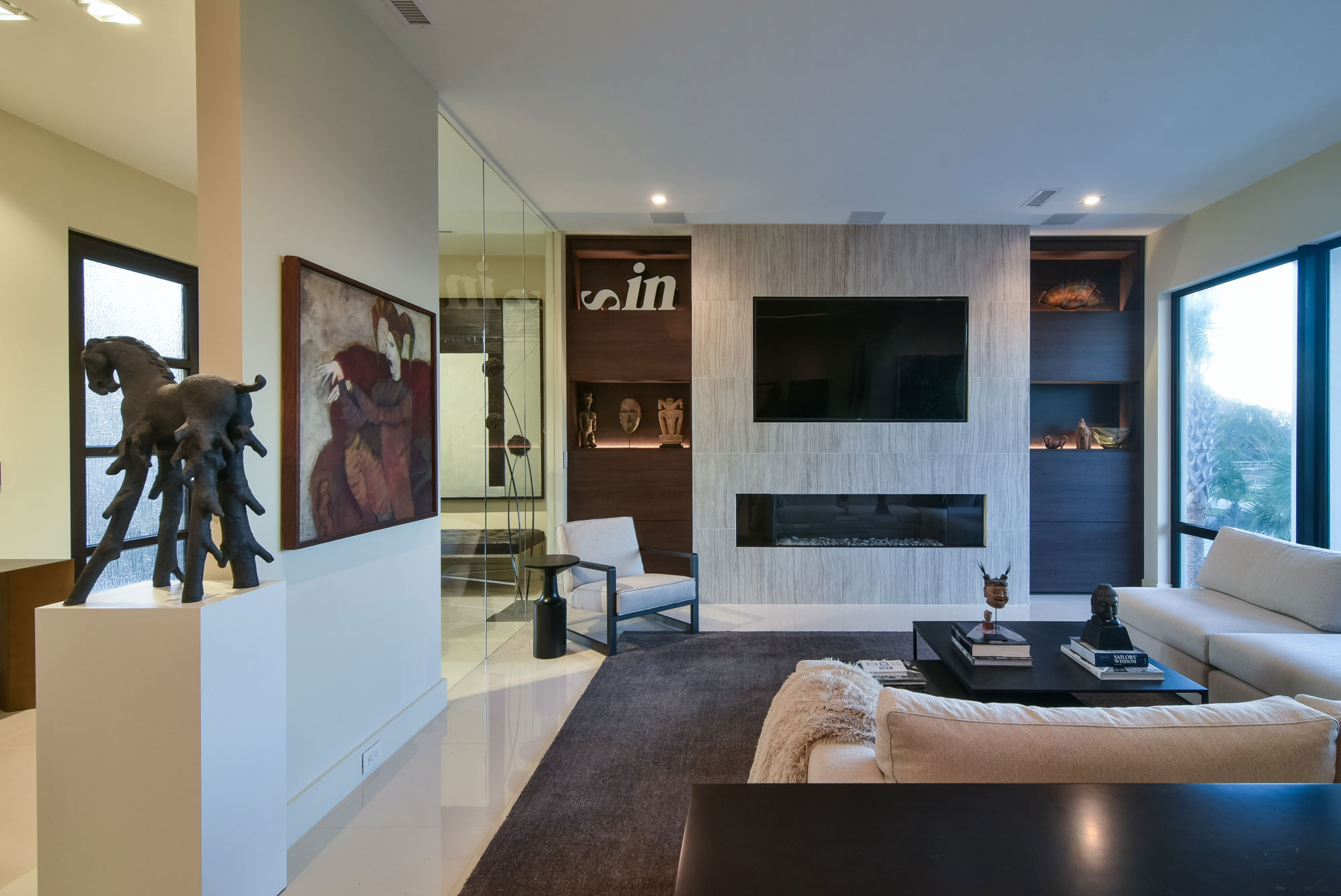 Formal living room with art collection