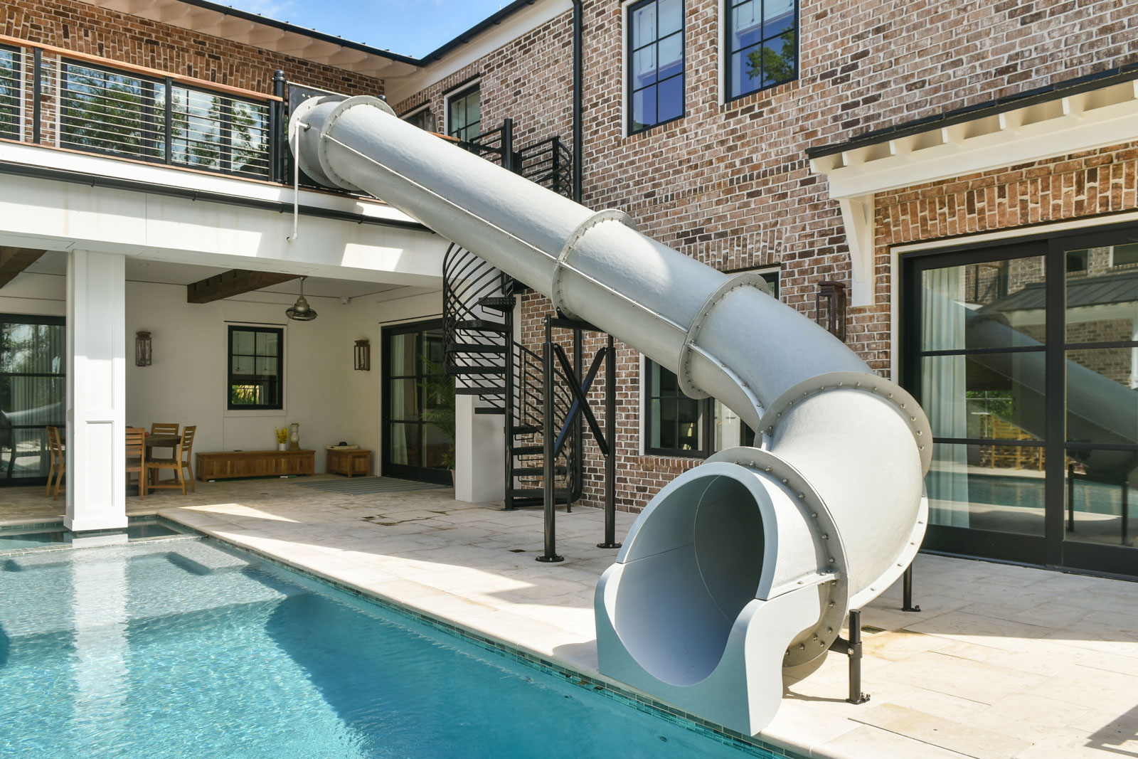 Pool courtyard with two story slide