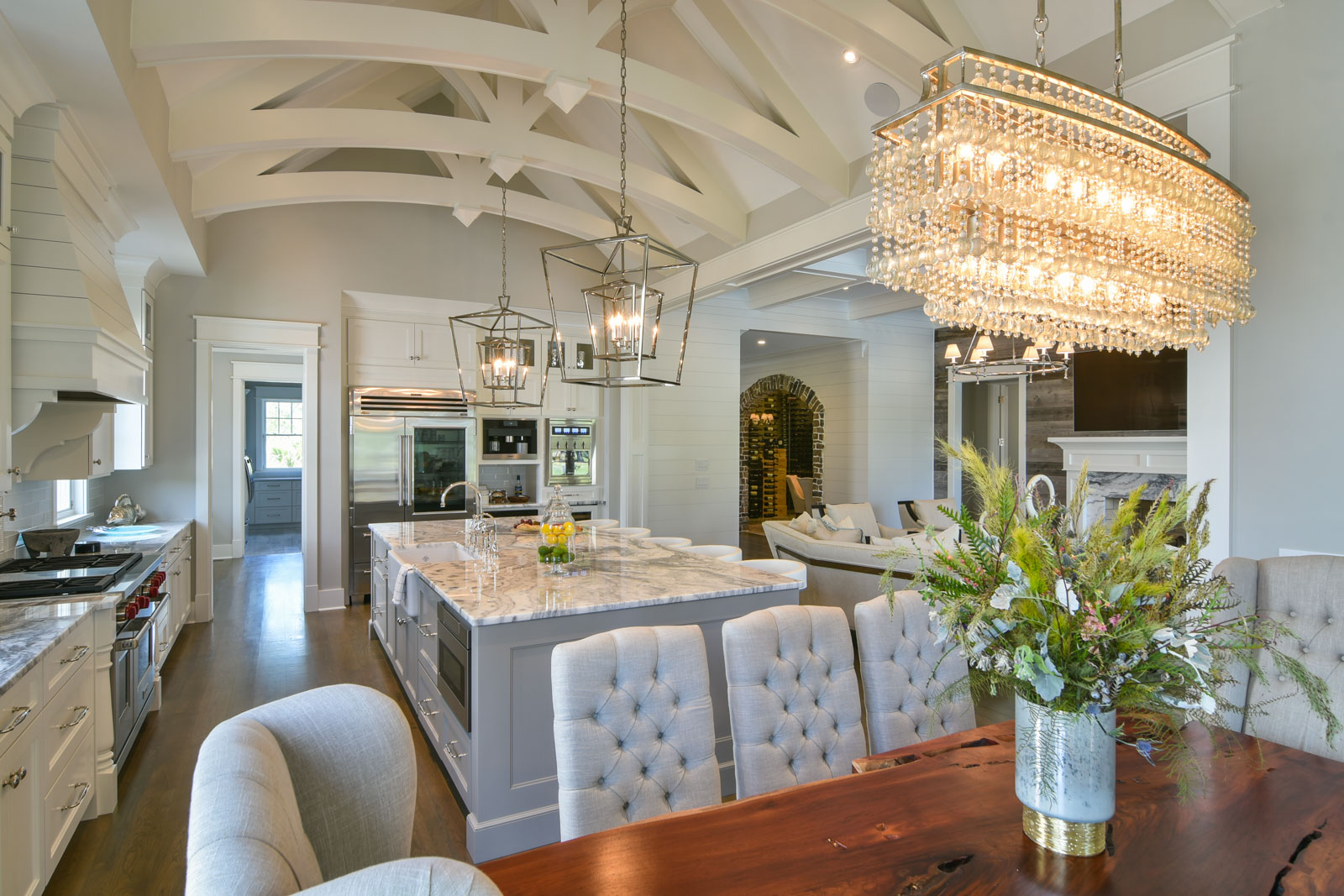 Luxury kitchen with white trusses and highend appliances